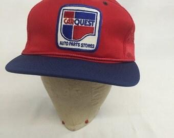 Vintage CARQUEST trucker hat. NFL trucker hat. Car hat. Car repair hat. Red, white and blue hat. Snap back hat. Mesh hat. Auto parts stores.