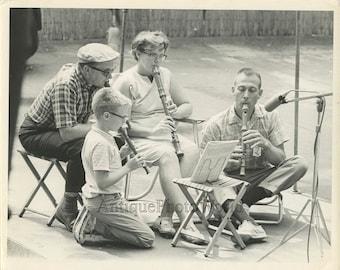 Recorder flute folk ensemble performing vintage photo