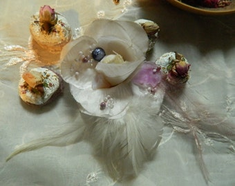 Delicate brroch with feathers and silk