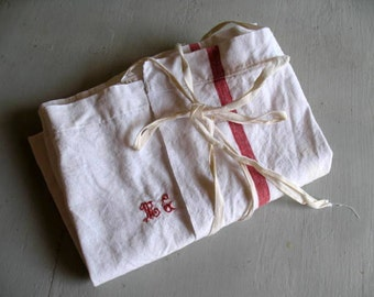 Antique French linen apron mongramed 'MG'.