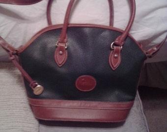 """NEW ITEM!  Vintage """"Dooney & Bourke"""" shoulder bag. Hunter green and tan. Double handles and shoulder strap. Like new."""
