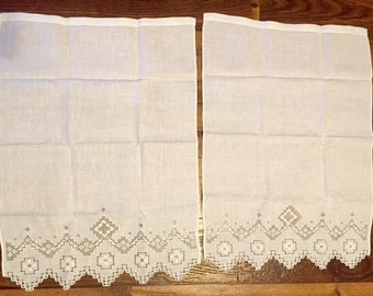 2 linen napkins with cut out embroidery