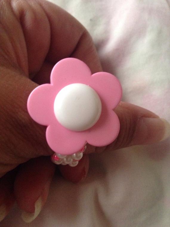 Plastic flower button ring
