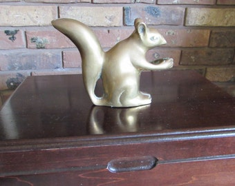 Small Brass Squirrel Figurine Eating Nut.