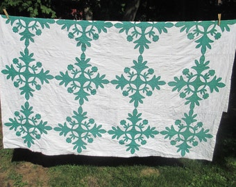 Large applique green and white quilt