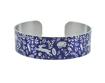 Woodland animals jewellery cuff bracelet, navy blue metal bangle with silver animals, rabbits, hares, hedgehogs, secret message gift. B380