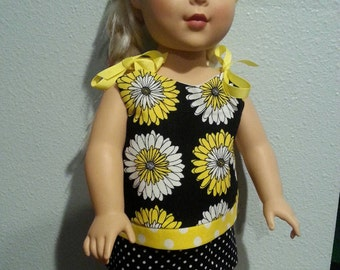 Doll top.. Skirt and hat. Black white and yellow. Fits 16-18 inch dolls