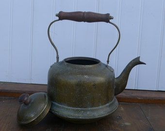 Brass tea pot with wooden handle