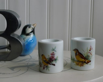 Pair of porcelain cylinder bird candle holders (yellow birds)
