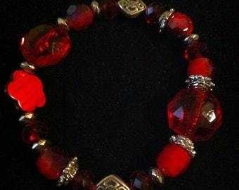 Red mix beaded Celtic knot bracelets.