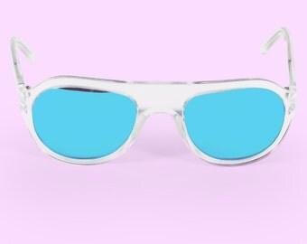 The Libertine   Sunglass   Crystal Clear In UltraMarine Blue Mirrored Lens