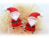 A pair of Santa Clauses.  Doll brooch. Pocket doll. Miniature toy