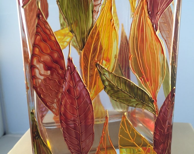 Glass rectangular vase with autumn leaves