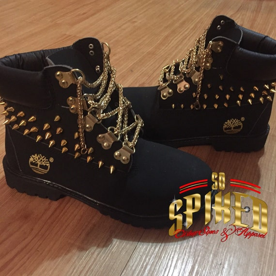 Black timberland boots with gold spikes