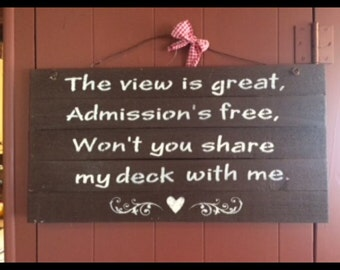Primitive Sign: The view is great, Admissions free, Won't you share my deck with me.