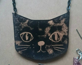 Cute cat necklace, hand carved linocut on shrink plastic. Black and copper.