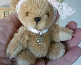 Poppy a gold miniature mohair teddy bear.