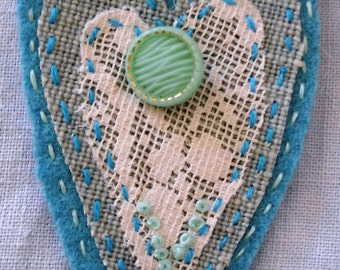 Turquoise textile brooch, with lace