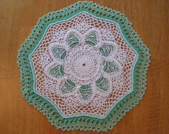 New hand-crocheted green and white doily