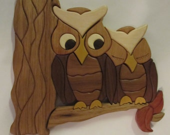 Intarsia owls on branch