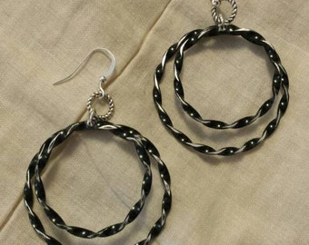 Black/silvertone double hoop earrings