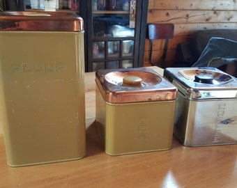 Lincoln Beauty Ware Chrome and Yellow Canisters