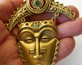 Tribal face pin