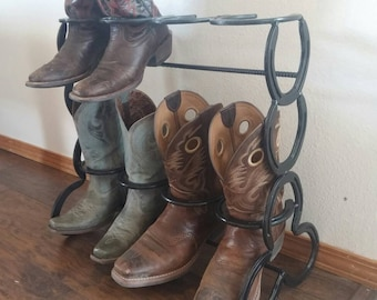 Horseshoe boot rack holds four pairs of boots.