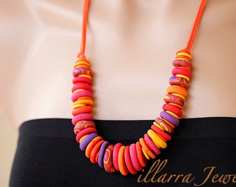 Polymer Clay Disk Bead Necklace in shades of Red, Orange, Yellow and Purple on Orange Suede Cord - OOAK