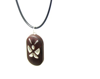 The illusionist locket, made of natural wood with Sterling Silver butterfly pattern,the deep color version.