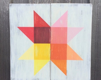 Colorful Rainbow Starburst Quilt Sign on Whitewashed Wood