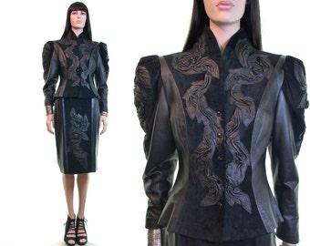 sculpted leather jacket + skirt suit   black leather suit   avant garde jacket + skirt suit set   peplum suit jacket