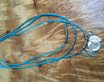Turqoise cord and sterling charm necklace
