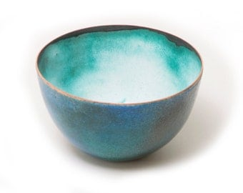Lovely enamelled copper bowl in blues, greens white and aqua