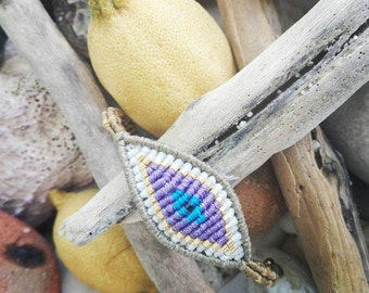 Large evil eye bracelet in olive green, white, gold and purple colors.