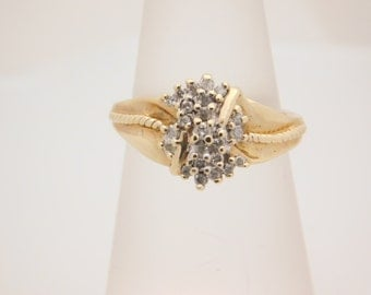 0.25 Carat T.W. Ladies Round & Baguette Cut Diamond Cluster Ring 10K Yellow Gold