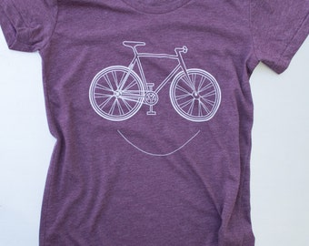 Women's smiling Bike, printed on american apparel tees. color plumb s,m,l,xl. free ship in US.