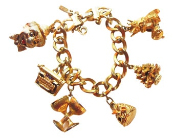 Vintage Monet Charm Bracelet With Mechanical And Still Charms Vintage 1960