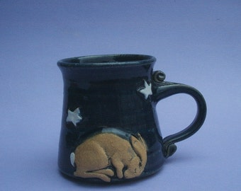 Mug  with a little hare sleeping under the stars