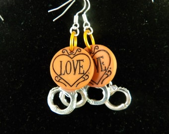 Orange love charm & silver handcuffs dangle earrings