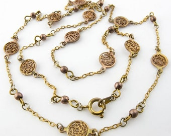 Vintage 2mm brass cable chain with copper filigree disk spacers  finished with clasp.  24 inches. b12-chn596(e)