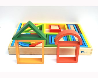 One  of these items (Rainbow Blocks, Car Transport Truck, Cattle Truck)