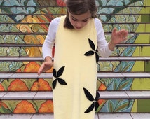 Buttercup terry dress with fall leaves.