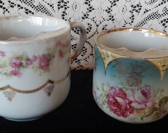 Two unmarked mustache cups with pink roses