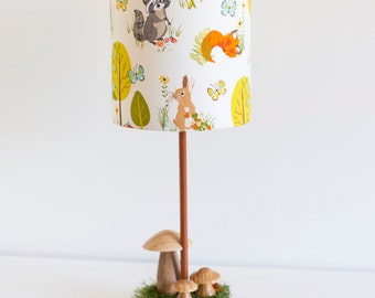 Woodland nursery natural wooden toadstool lamp with woodland creatures barrel lamp shade featuring fox, deer and racoon