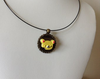 Cookie Bear Black Wire necklace. Poor little guy has a bite in his cheek. Hungry?