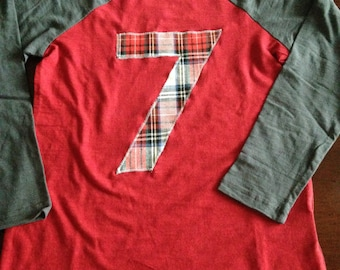7 birthday shirt with red and white classic plaid on a red and grey long sleeve shirt, size small 6/7.