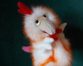 Cock. Toy on hand. Bibabo. Toy glove. Puppet theatre. Marionette.