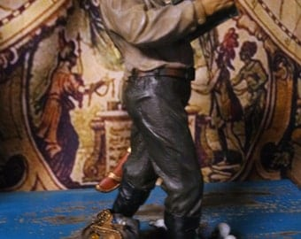 Figurine of a Pirate Carrying His Treasure Chest