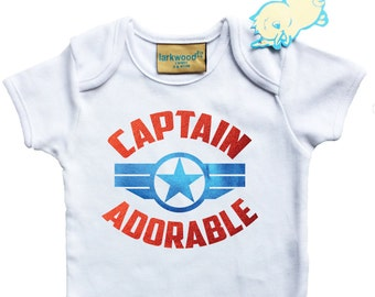 Captain America Baby grow with blue and red foil emblem and text.